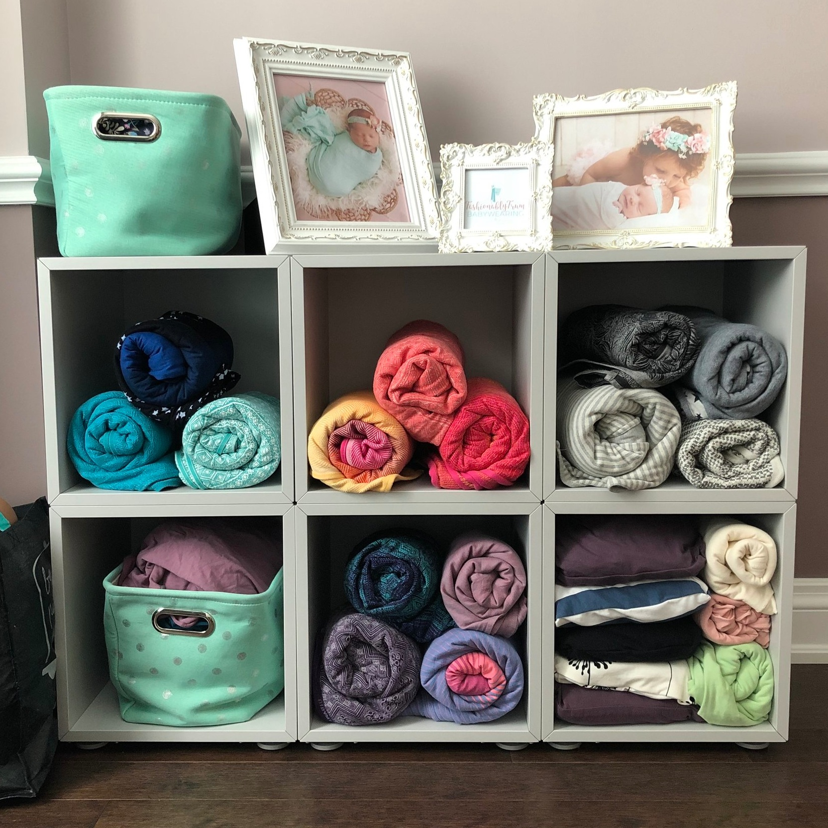 Woven wraps and stretchy wraps on display at the babywearing studio.