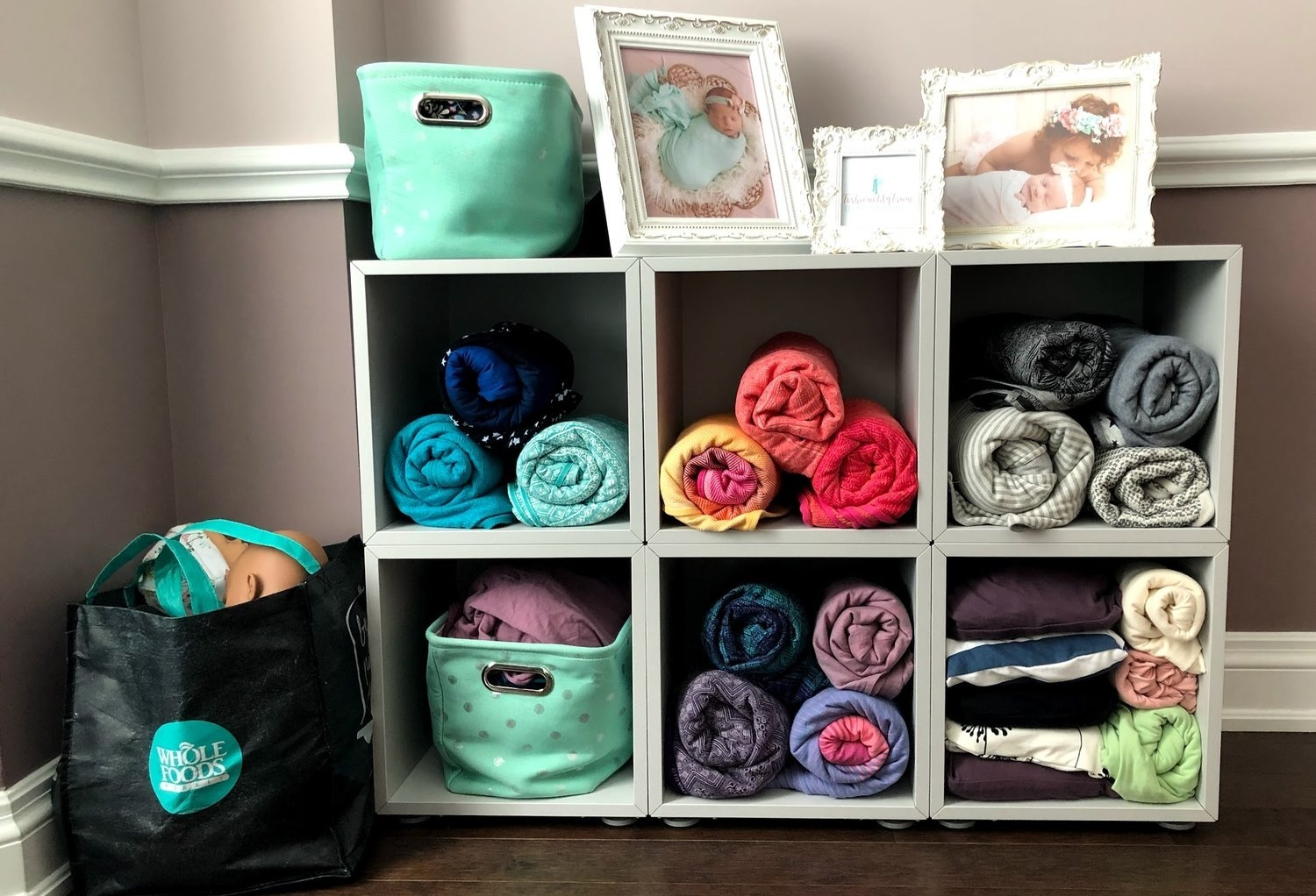 Avie's large collection of woven baby wraps and stretchy wraps, from Didymos, Soul Slings, Boba, Baby K'tan and Huggaloops and weighted babywearing dolls.