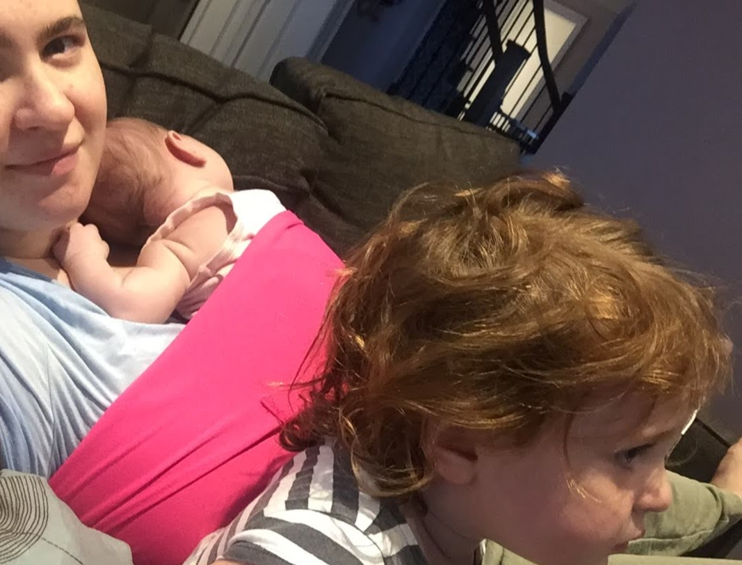 Using the SleepBelt to rest on the couch with baby.