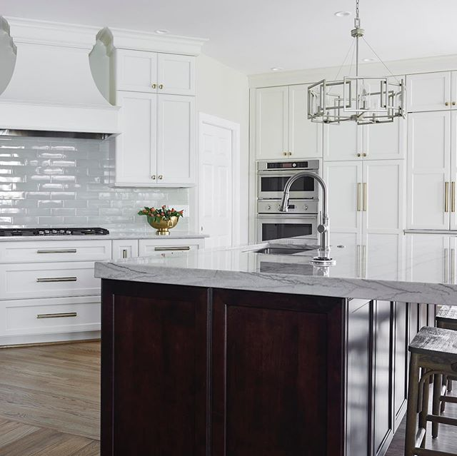 Fun new kitchen with brushed brass hardware, double edge on the island, different color island cabinets from perimeter cabinets, pop-up outlet in countertop allows plenty of plug spaces and no cutting into the cabinets, mudroom for kids and sports! #RVAinteriors #kitchens #mudrooms #richmondinteriors