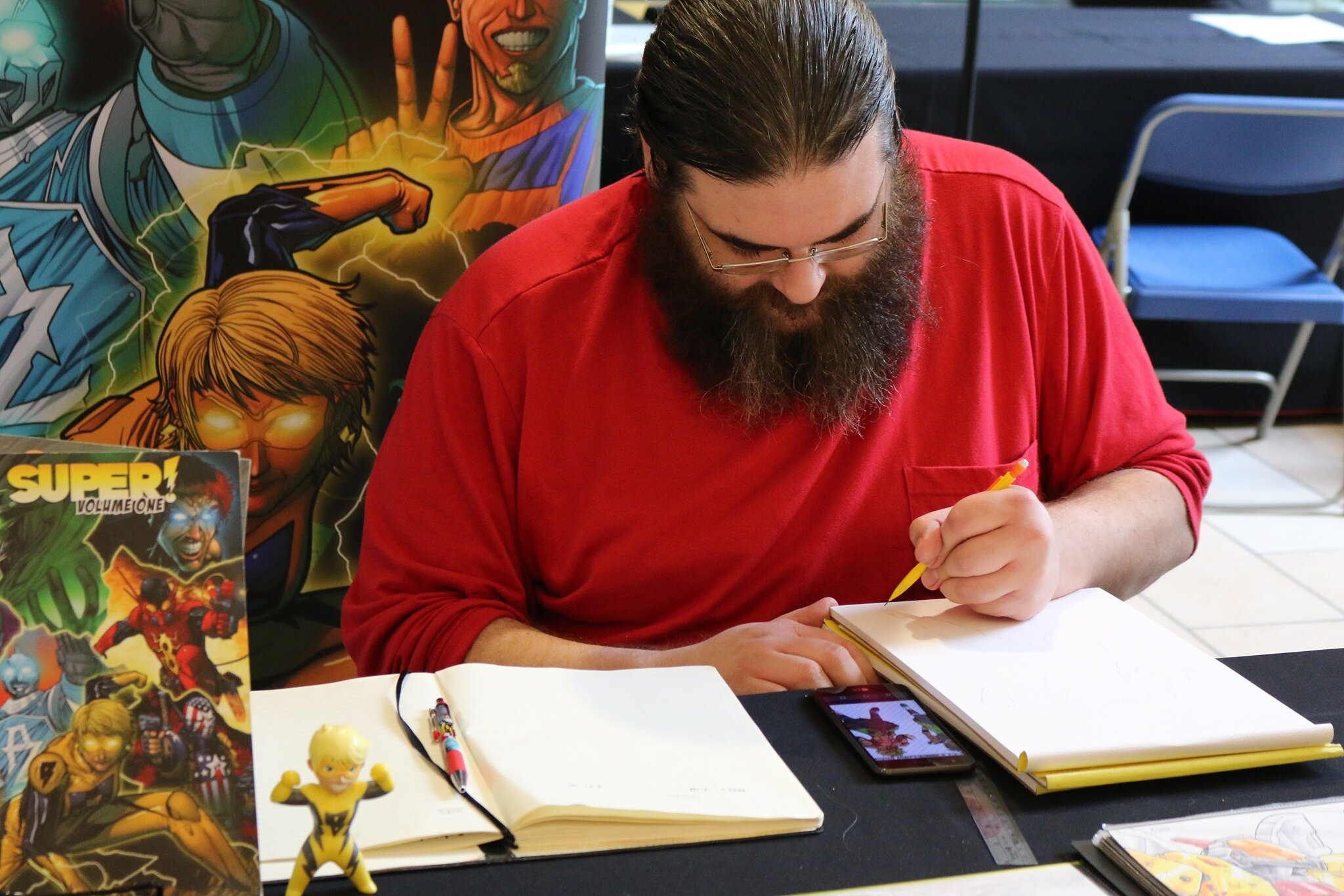 Here's Zack doing a sketch commission.