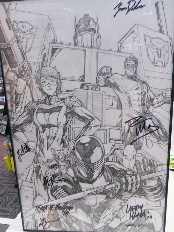 All the characters represented a different guest that year and we got them all to sign near their character. This piece has been on display at our store ever since.