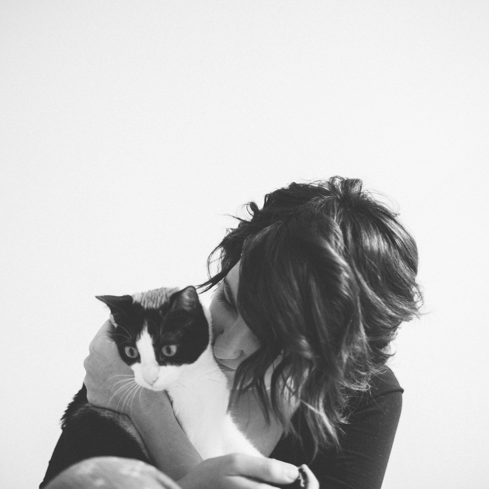 Girl with a cat in black and white