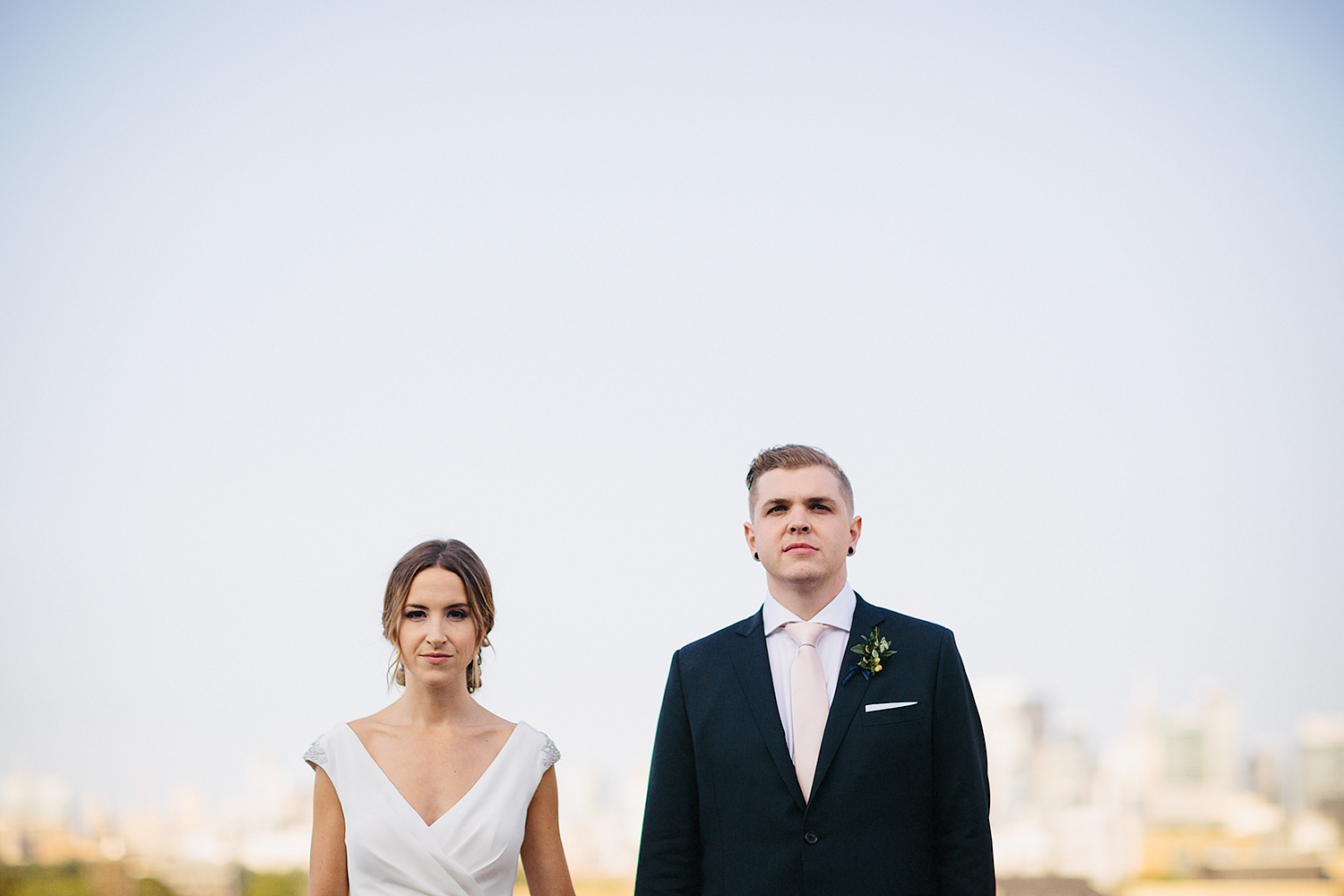 Toronto-City-Hipster-Wedding-Gladstone-hotel-vintage-couple-pose-stoic.jpg