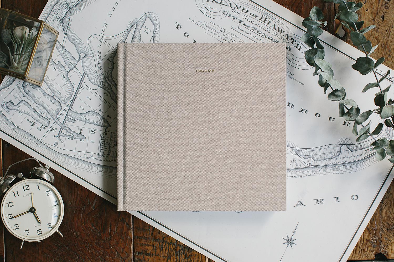album-designer-toronto-design-work-wedding-album-custom-and-affordable-linen-fine-art-album-title-gold-foil-engraved-artifact-uprising.jpg