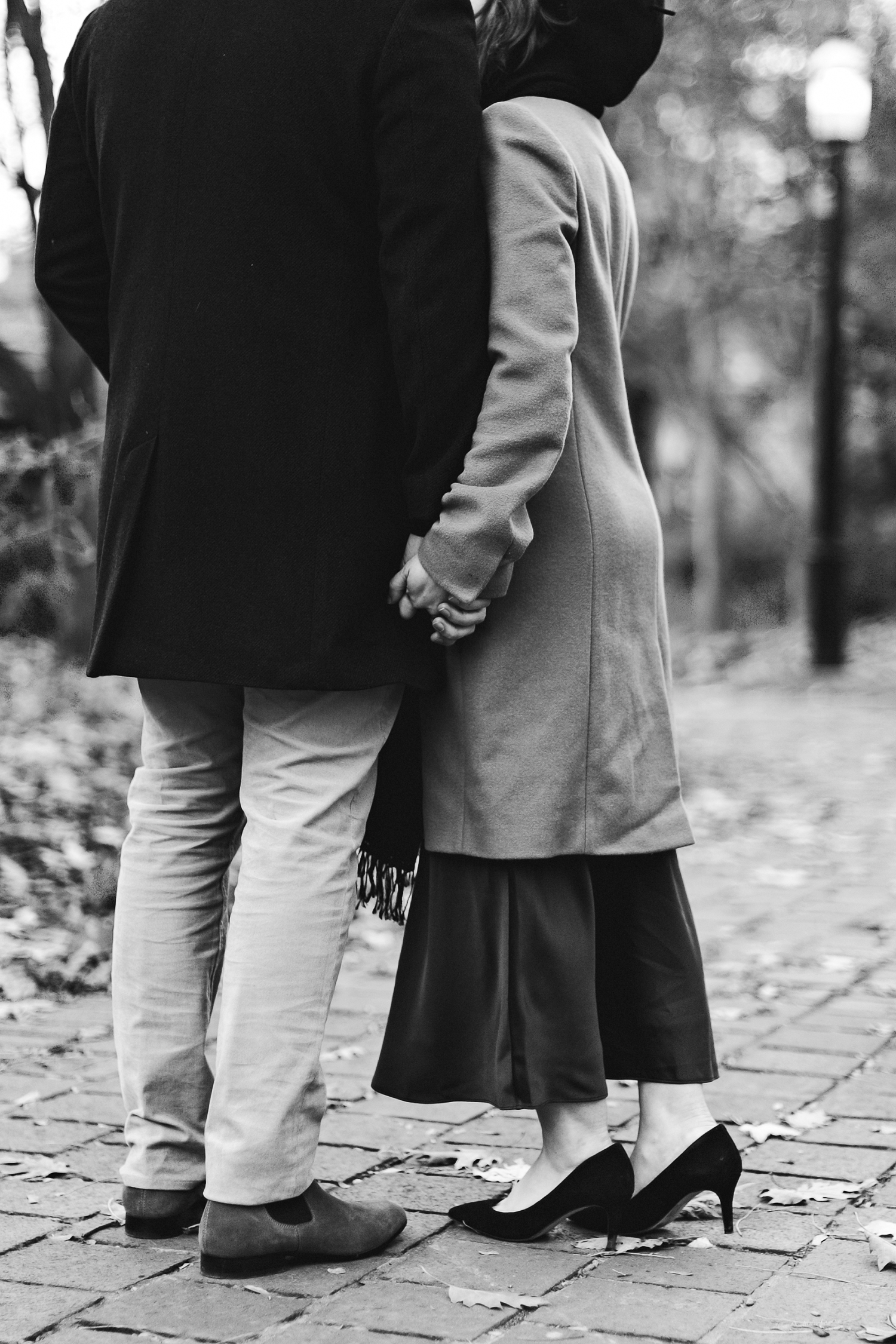 alternative-engagement-photographer-lifestyle-session-ryanne-hollies-photography-toronto-st-james-park-editorial-city-urban-mens-womens-fashion-magazine-cover-intimate-streetstyle-alternative-park-holding-hands.jpg