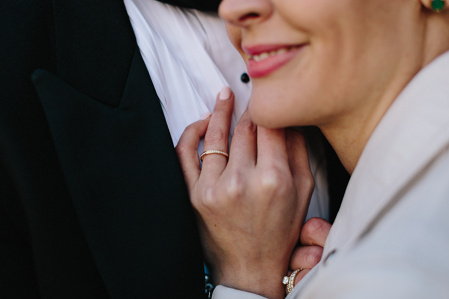 elopement-wedding-old-city-hall-nathan-phillips-square-toronto-wedding-photographer-ryanne-hollies-photography-candid-documentary-portraits-of-bride-and-groom-osgoode-hall-toronto-photo-location-trendy-cool-couple-ring-details.jpg