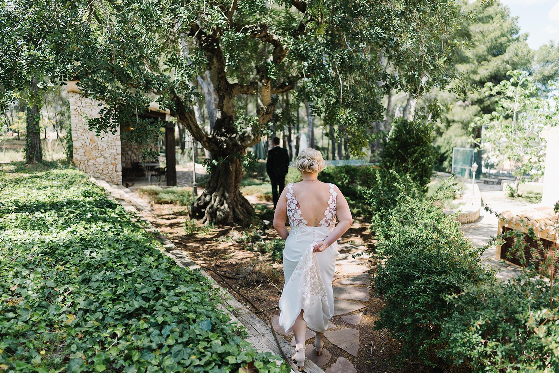 european-wedding-spain-wedding-photographer-destination-wedding-photographer-from-toronto-ryanne-hollies-photography-documentary-editorial-style-toronto-wedding-photographer-first-look-bride-walking-up-to-groom-outdoor-oasis.jpg
