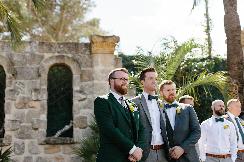 photographer-destination-wedding-photographer-from-toronto-ryanne-hollies-photography-documentary-editorial-style-toronto-wedding-photographer-junebug-weddings-ceremony-groom-waiting-for-his-bride.jpg