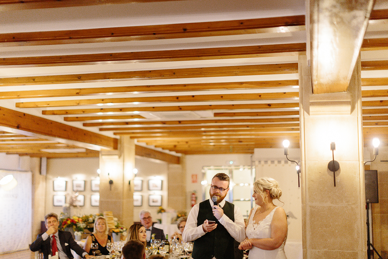 photographer-destination-wedding-photographer-from-toronto-ryanne-hollies-photography-documentary-editorial-style-toronto-wedding-photographer-junebug-weddings-reception-bride-and-groom-speech.jpg