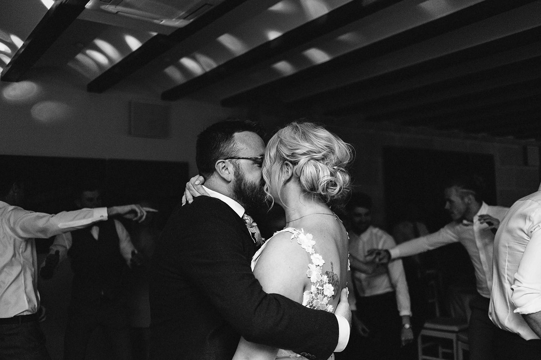 photographer-destination-wedding-photographer-from-toronto-ryanne-hollies-photography-documentary-editorial-style-toronto-wedding-photographer-junebug-weddings-reception-bride-and-groom-first-dance-70s-themed-fun-goofy-kiss.jpg