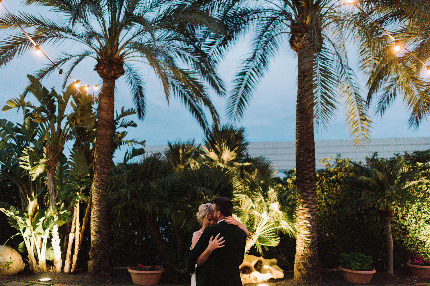 photographer-destination-wedding-photographer-from-toronto-ryanne-hollies-photography-documentary-editorial-style-toronto-wedding-photographer-junebug-weddings-reception-bride-and-groom-sunset-portraits-blue-hour-palms-string-lights-moments.jpg