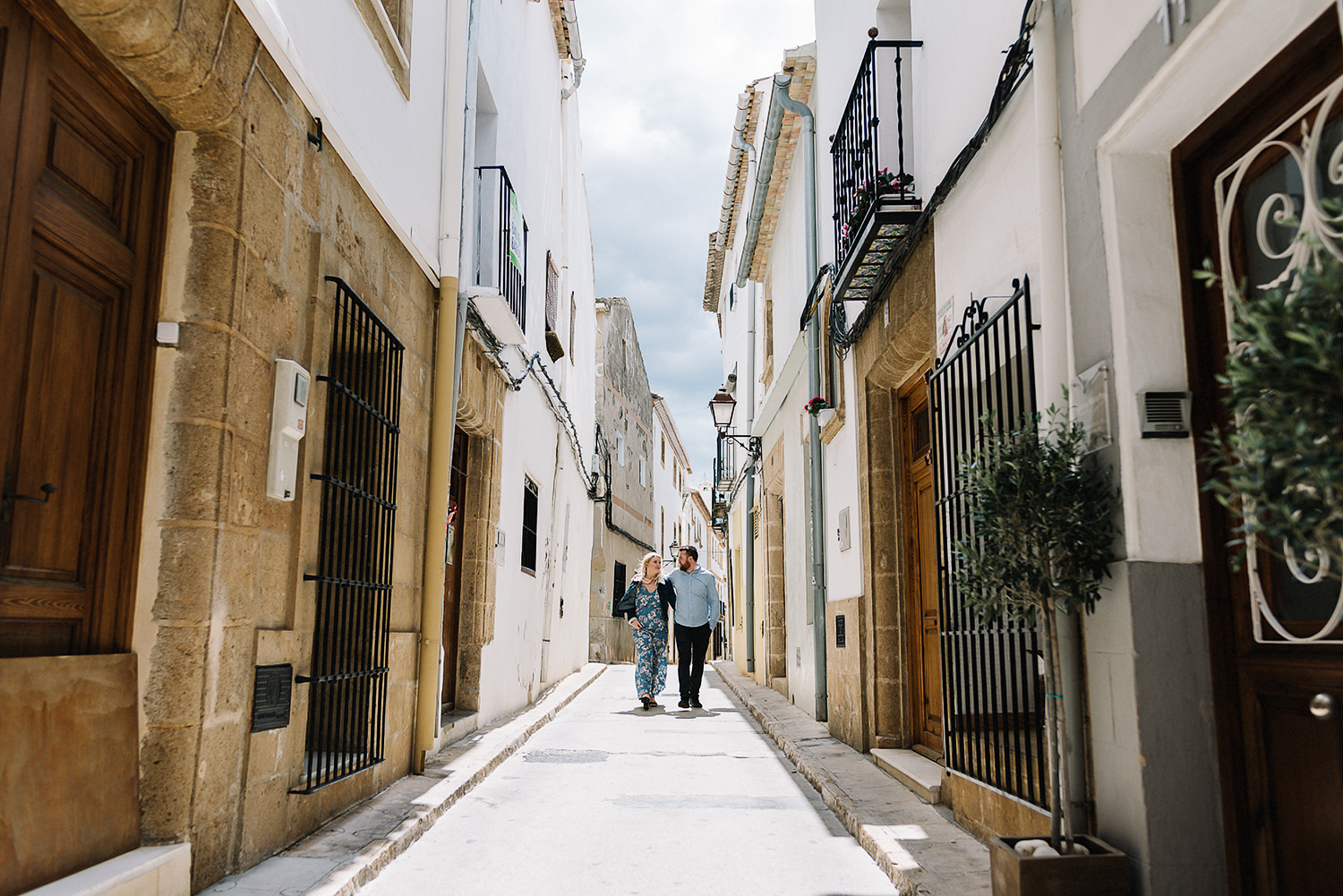 spanish-engagement-session-valencia-spain-toronto-wedding-photographer-ryanne-hollies-photography-old-town-jaxier-old-spanish-architecture-intimate-candid-real-moment-between-couple-romantic-walking-candid-sun-kissed.jpg