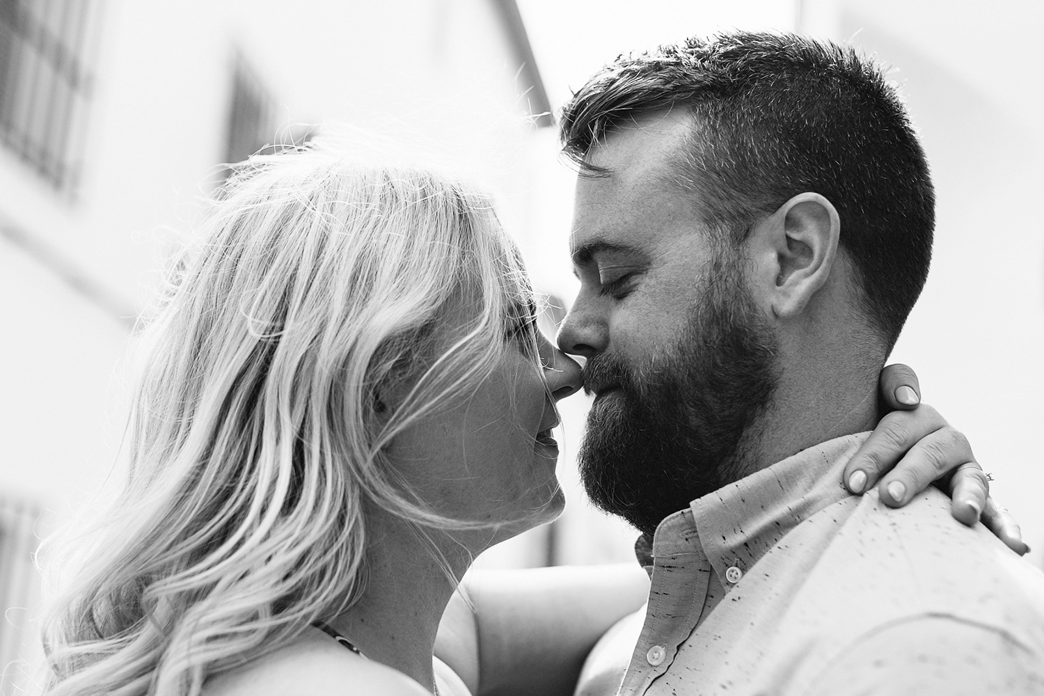 spain-toronto-wedding-photographer-ryanne-hollies-photography--intimate-candid-real-moment-between-couple-romantic-engagement-session-inspiration-alley-alleyway-using-light-epic-cool-trendy-details-floral-dress-moments-bw.jpg