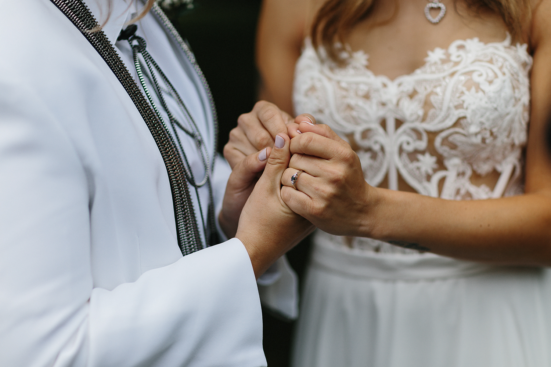 cambium-farms-wedding-ryanne-hollies-photography-gay-wedding-farm-wedding-inspiriration-green-wedding-shoes-couples-portraits-rustic-barn-vintage-trendy-badass-couple-intimate-romantic-engagement-ring-lesbian-wedding.jpg