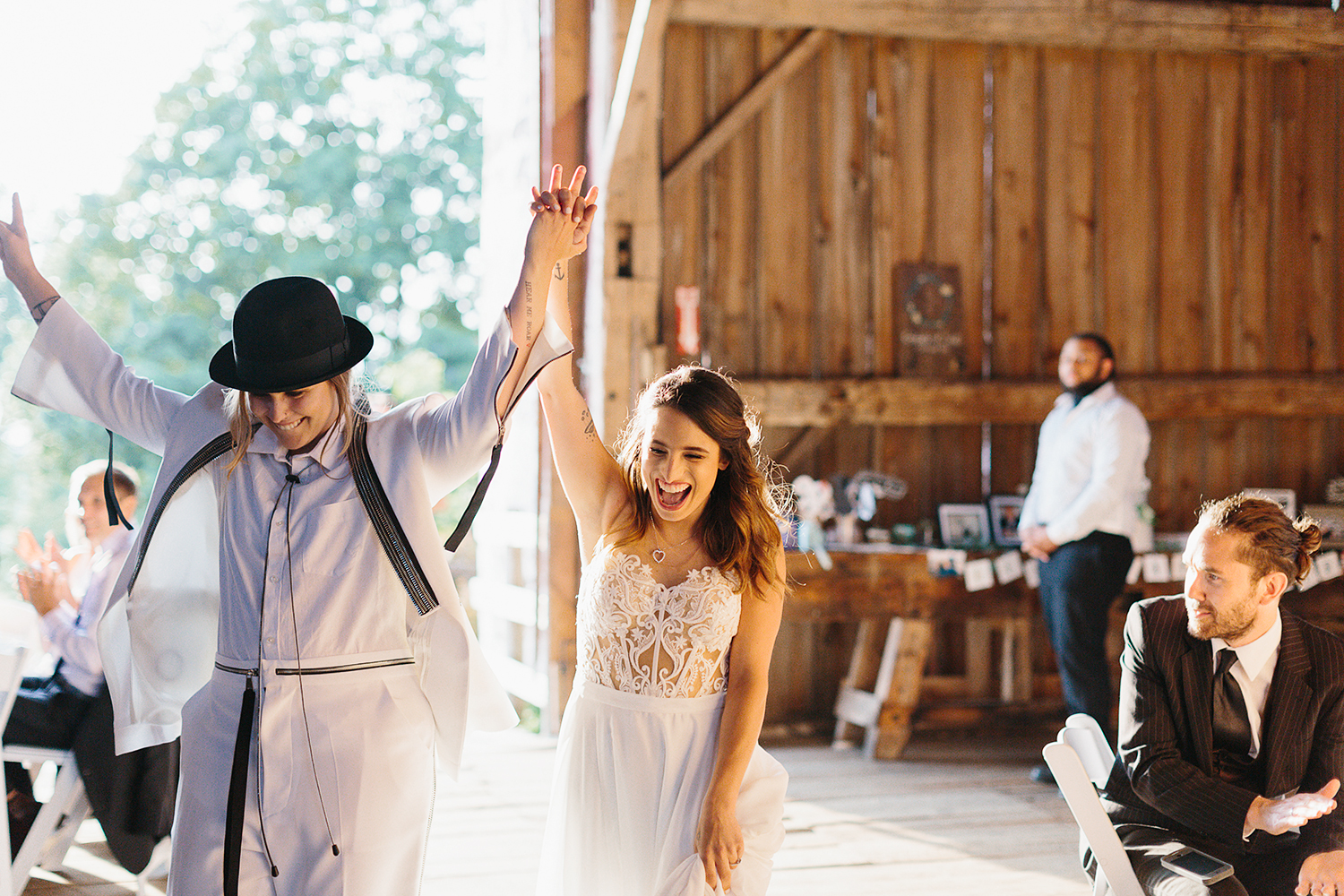 colour-cambium-farms-wedding-ryanne-hollies-photography-gay-wedding-lgbtq-trendy-cool-badass-junebug-weddings-inspiration-wedding-reception-in-a-barn-entrance-of-brides.jpg