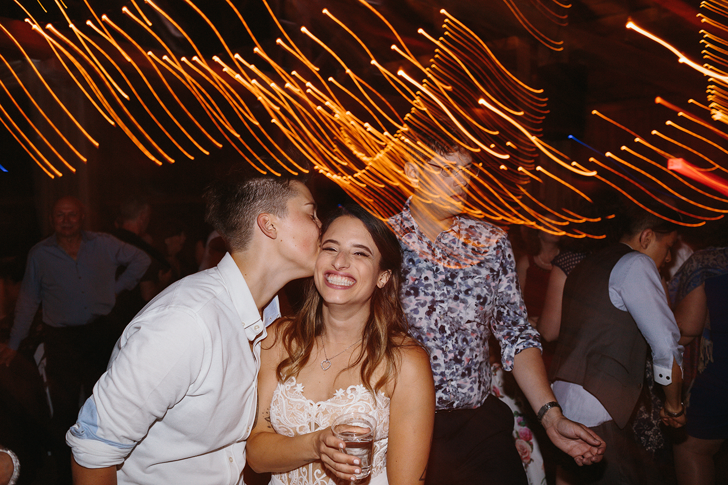 cambium-farms-ryanne-hollies-photography-gay-wedding-lgbtq-trendy-cool-badass-junebug-weddings-inspiration-wedding-reception-huge-party-candid-fun-moments-memories-friends-partying-kissing-love-is-love-bride-with-girlfriends.jpg