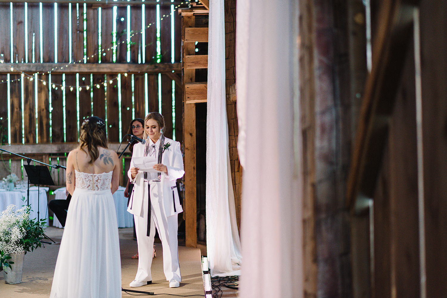 cambium-farms-wedding-ryanne-hollies-photography-gay-wedding-lgbtq-trendy-cool-badass-junebug-weddings-inspiration-ceremony-in-old-barn-bride-and-bride-vows-crying-reaction-support-gay-marriage-love-is-love.jpg