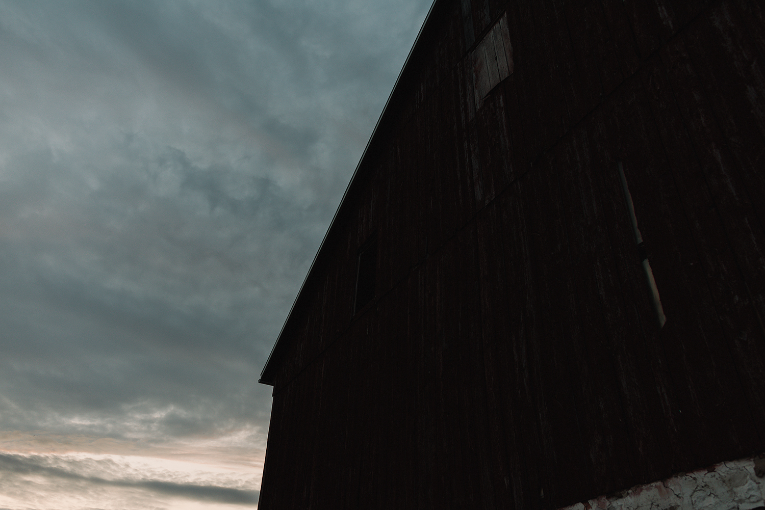 cambium-farms-wedding-ryanne-hollies-photography-gay-wedding-lgbtq-trendy-cool-badass-junebug-weddings-inspiration-wedding-reception-in-a-barn-portraits-at-sunset-carzy-colours-in-the-sky-barn-at-night.jpg