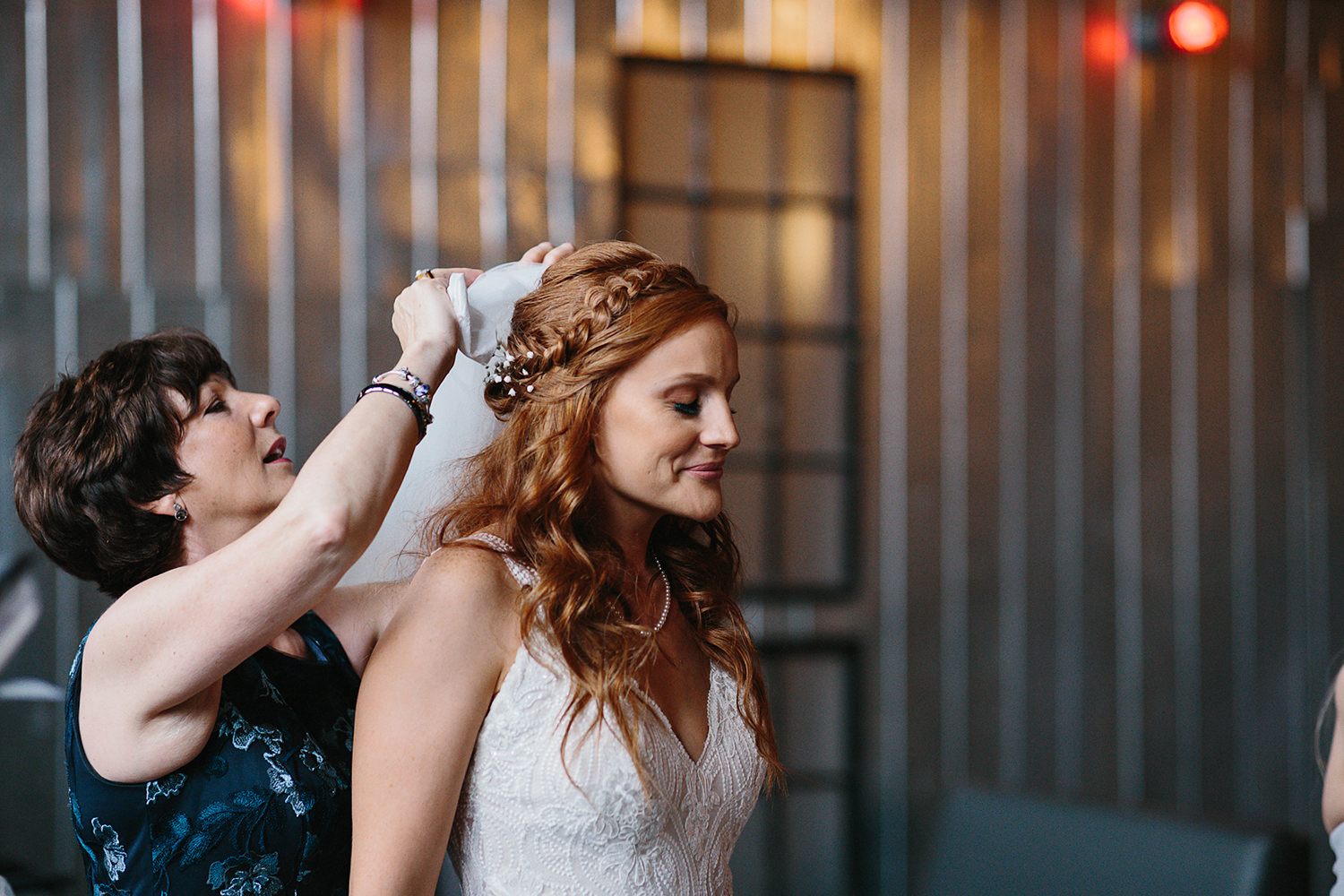 downtown-toronto-wedding-photographer-ryanne-hollies-photography-airship37-distillery-district-wedding-day-modern-minimalist-venues-in-toronto-cool-trendy-hipster-bride-getting-ready-mom-putting-on-veil-emotional-crying.jpg