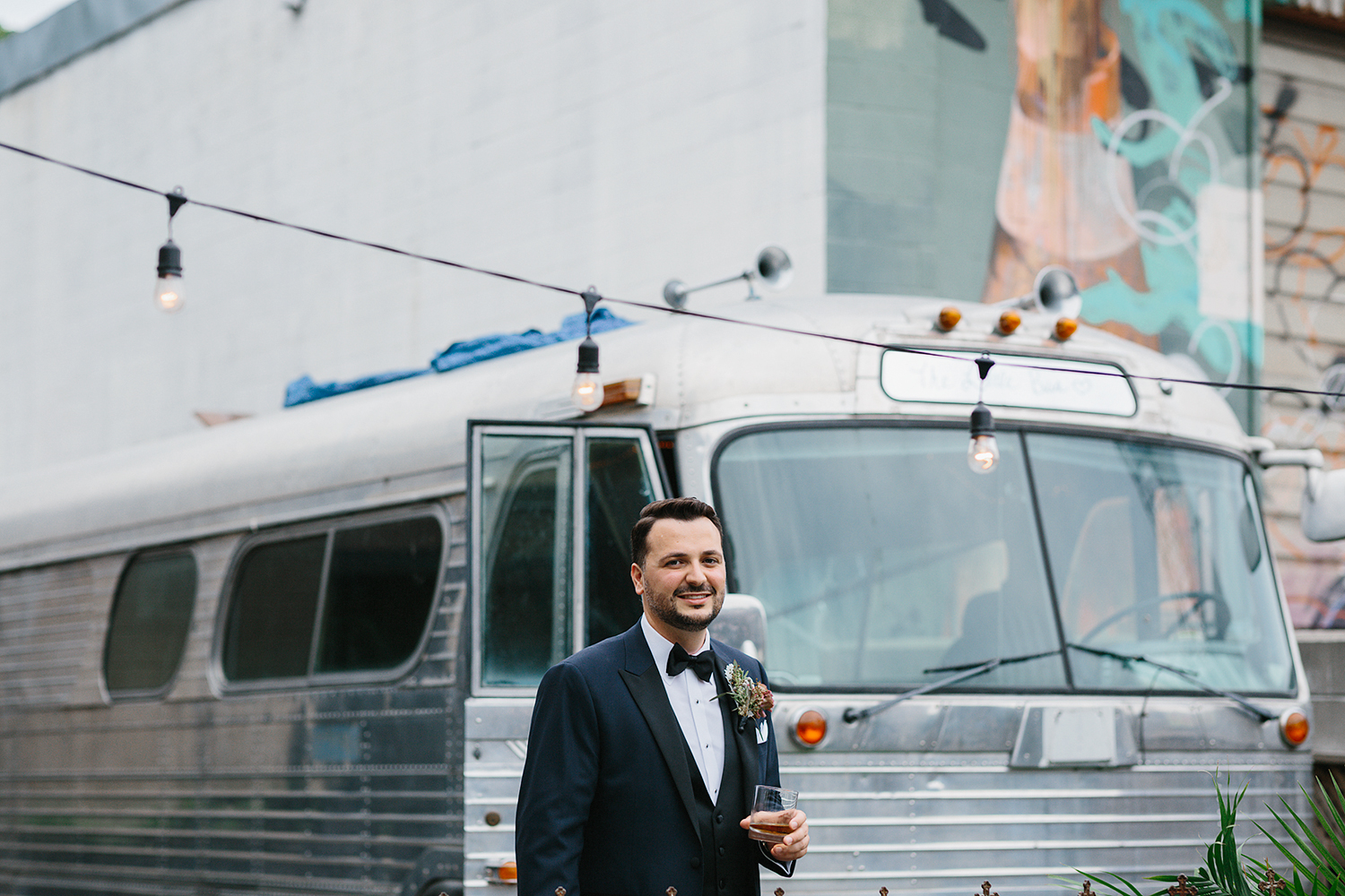 downtown-toronto-wedding-photographer-ryanne-hollies-photography-airship37-distillery-district-wedding-day-modern-minimalist-venues-in-toronto-cool-trendy-hipster-party-bus-outdoor-patio-graffiti-groom-portraits.jpg