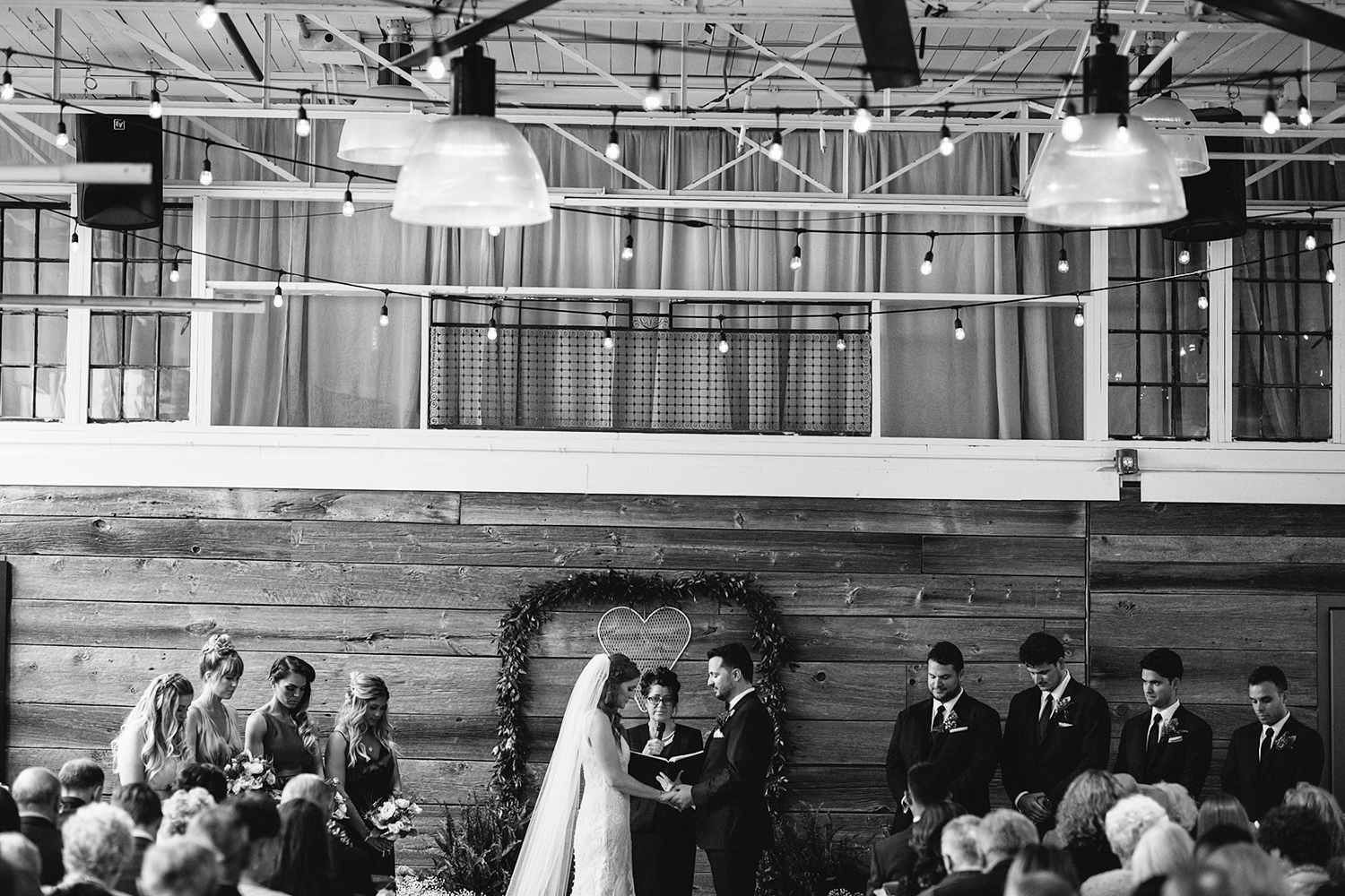 downtown-toronto-wedding-photographer-ryanne-hollies-photography-airship37-distillery-district-wedding-day-modern-minimalist-venues-in-toronto-ceremony-documentary-moments-bride-and-groom-saying-vows-and-prayers.jpg