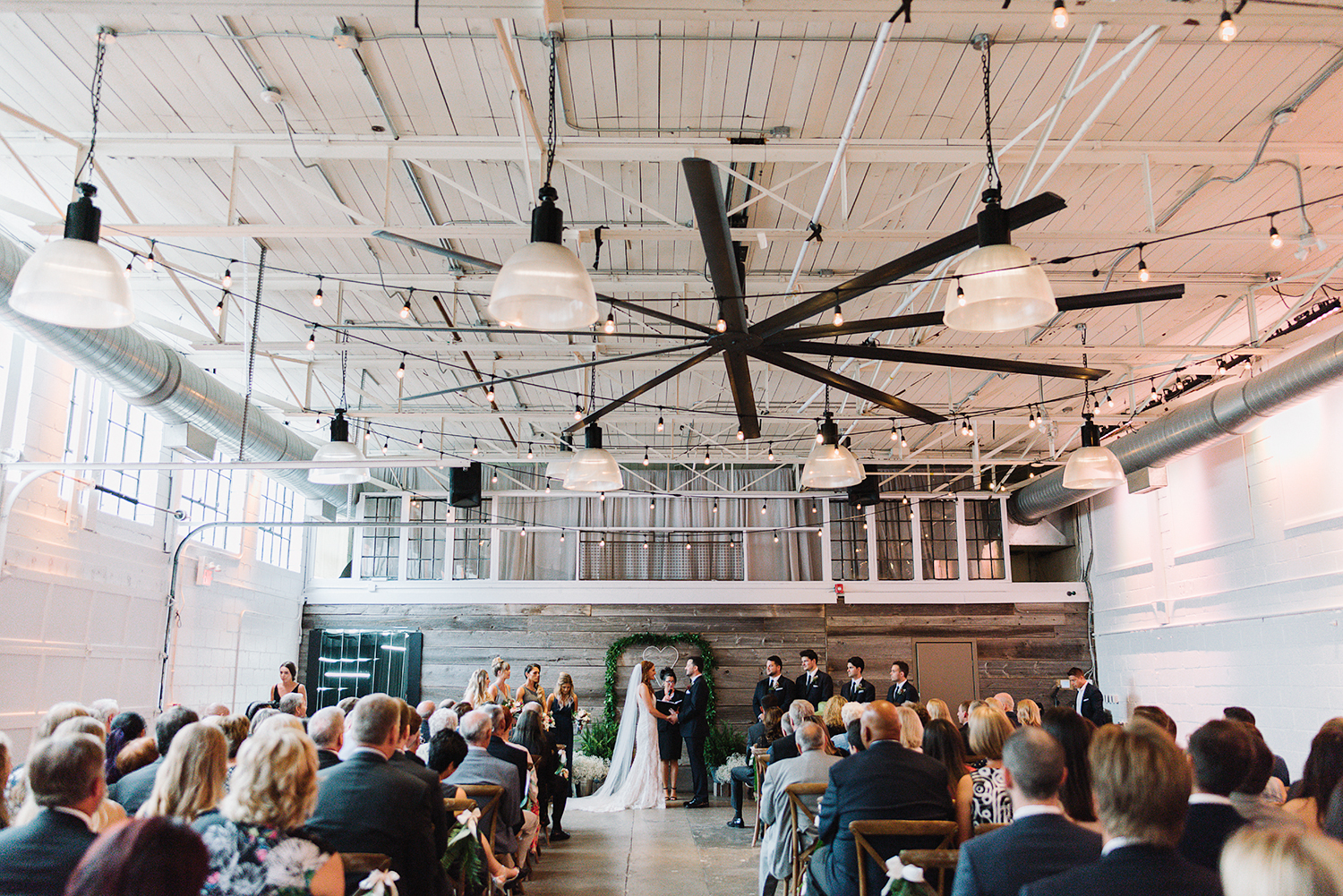downtown-toronto-wedding-photographer-ryanne-hollies-photography-airship37-distillery-district-wedding-day-modern-minimalist-venues-in-toronto-junebug-weddingsceremony-bride-and-groom-saying-vows-emotional-beautiful-epic-view.jpg