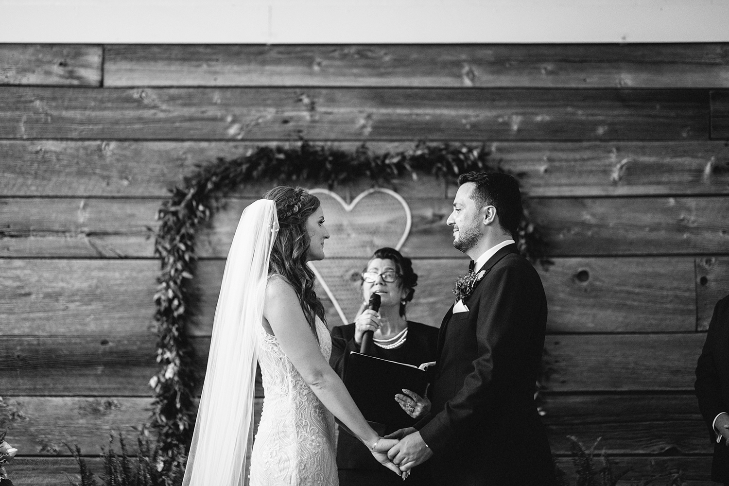 downtown-toronto-wedding-photographer-ryanne-hollies-photography-airship37-distillery-district-wedding-day-modern-minimalist-venues-in-toronto-ceremony-documentary-moments-bride-and-groom-saying-vows-emotional-beautiful-bw.jpg
