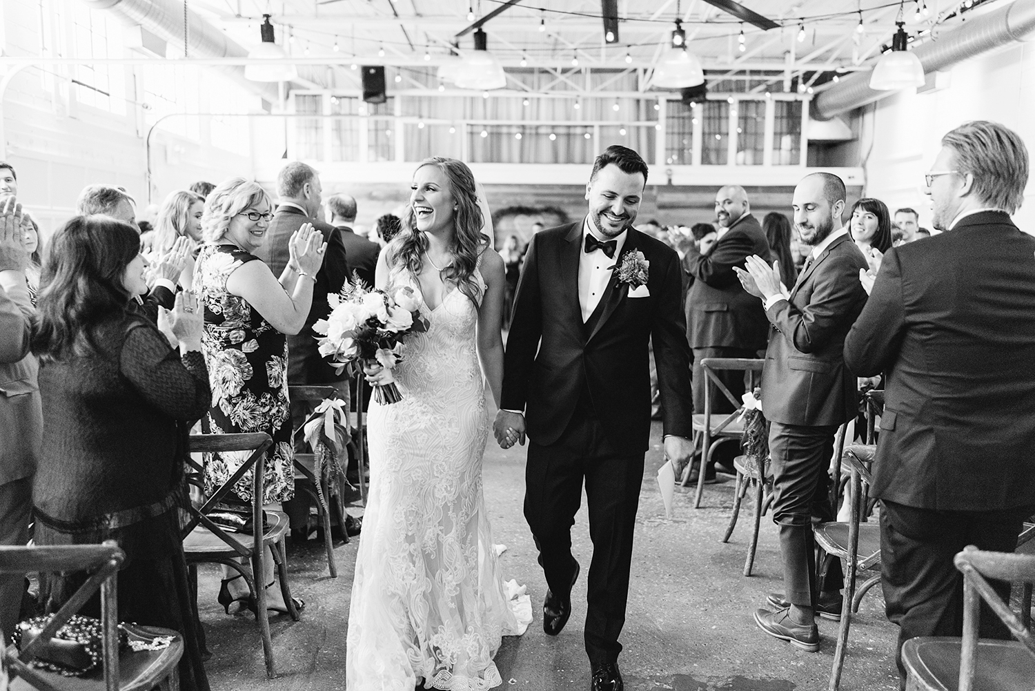 downtown-toronto-wedding-photographer-ryanne-hollies-photography-airship37-distillery-district-wedding-day-modern-minimalist-venues-in-toronto-ceremony-documentary-moments-bride-and-groom-just-married-recessional-epic-walking-down-aisle-bw.jpg
