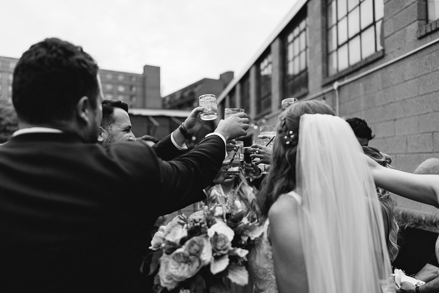 torontos-best-documentary-wedding-photographers-ryanne-hollies-photography-fine-art-photojournalism-artistic-moody-creative-inspiration-downtown-toronto-airship37-venue-modern-hipster-cocktail-hour-bridal-party-cheers-bw.jpg