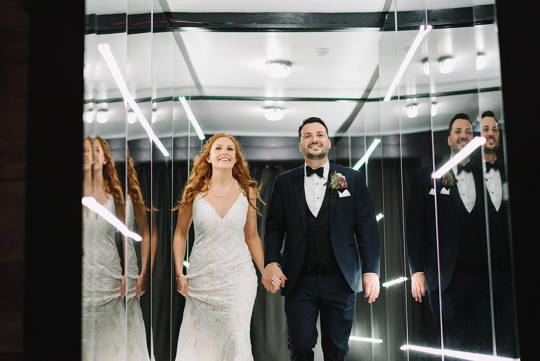 torontos-best-wedding-photographers-ryanne-hollies-photography-photojournalism-artistic-moody-toronto-airship37-graffiti-editorial-reception-bride-and-groom-entrance-dancing.jpg