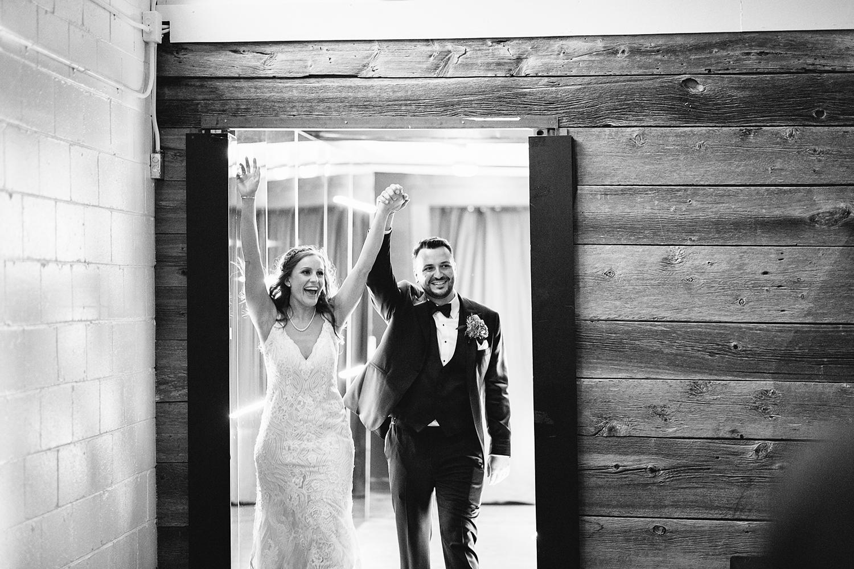 torontos-best-wedding-photographers-ryanne-hollies-photography-photojournalism-artistic-moody-toronto-airship37-graffiti-editorial-reception-bride-and-groom-entrance.jpg