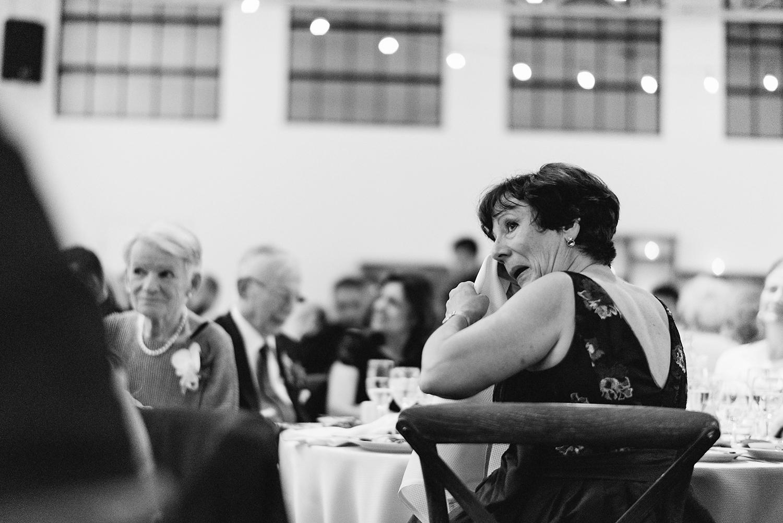 torontos-best-wedding-photographers-ryanne-hollies-photography-photojournalism-artistic-moody-toronto-airship37-graffiti-editorial-reception-bride-and-groom-speech-mom-crying.jpg