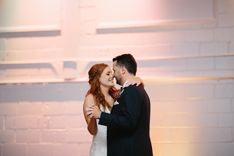 torontos-best-wedding-photographers-ryanne-hollies-photography-photojournalism-artistic-moody-toronto-airship37-graffiti-editorial-reception-bride-and-groom-first-dance.jpg