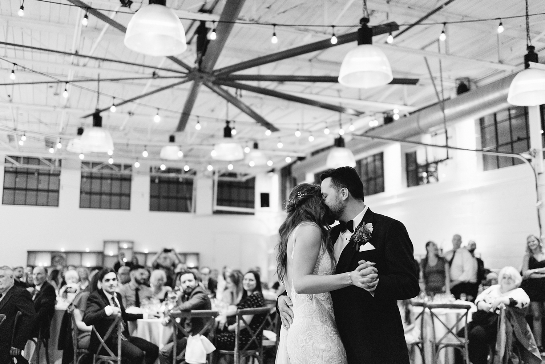 torontos-best-wedding-photographers-ryanne-hollies-photography-photojournalism-artistic-moody-toronto-airship37-graffiti-editorial-reception-bride-and-groom-first-dance-emotional.jpg