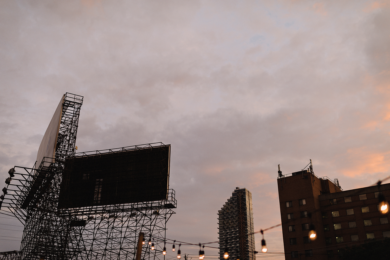 torontos-best-wedding-photographers-ryanne-hollies-photography-photojournalism-artistic-moody-toronto-airship37-graffiti-editorial-reception-outdoor-details-sunset-urban-string-lights-moody-pink-sky.jpg