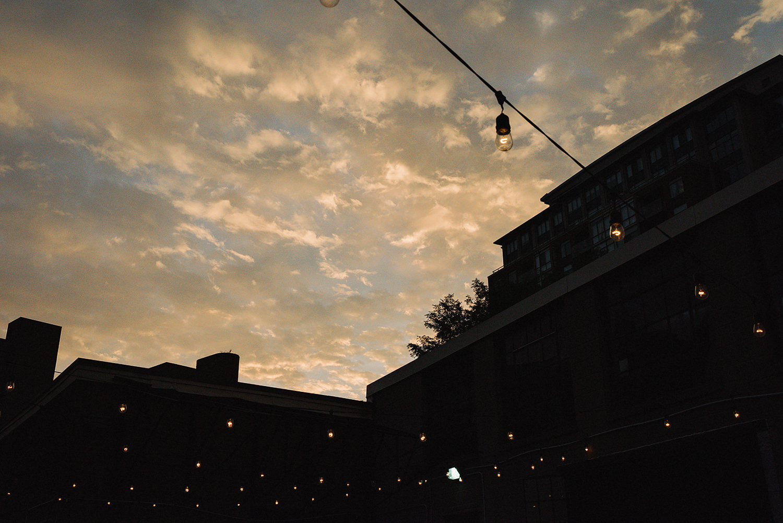 torontos-best-wedding-photographers-ryanne-hollies-photography-photojournalism-artistic-moody-toronto-airship37-graffiti-editorial-reception-outdoor-details-sunset-urban-string-lights-moody.jpg