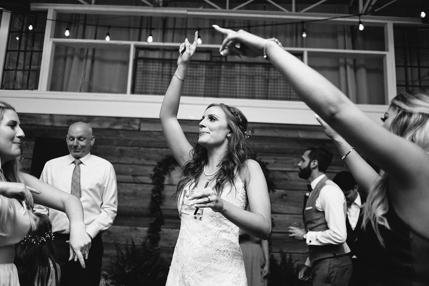 torontos-best-wedding-photographers-ryanne-hollies-photography-photojournalism-artistic-moody-toronto-airship37-graffiti-editorial-reception-dancing-together-hilarious-good-times-memories-bride-singing-partying-to-good-charolette.jpg