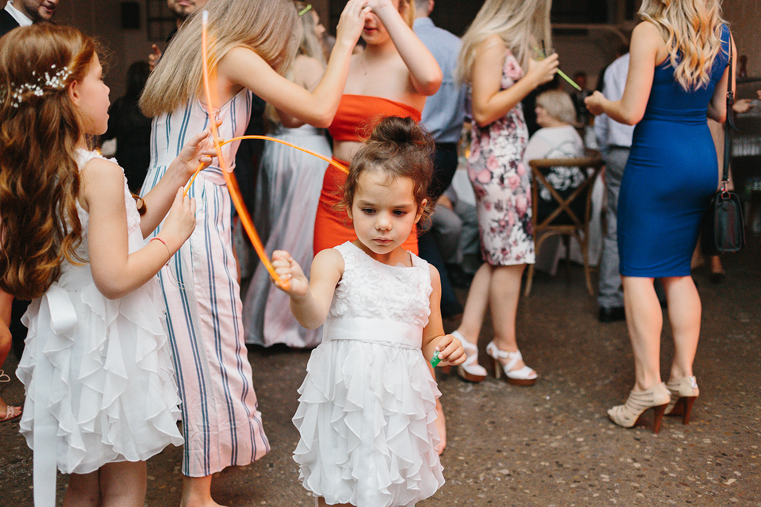 torontos-best-wedding-photographers-ryanne-hollies-photography-photojournalism-artistic-moody-toronto-airship37-graffiti-editorial-reception-dancing-together-hilarious-good-times-memories-cute-little-kid-with-glo-sticks.jpg
