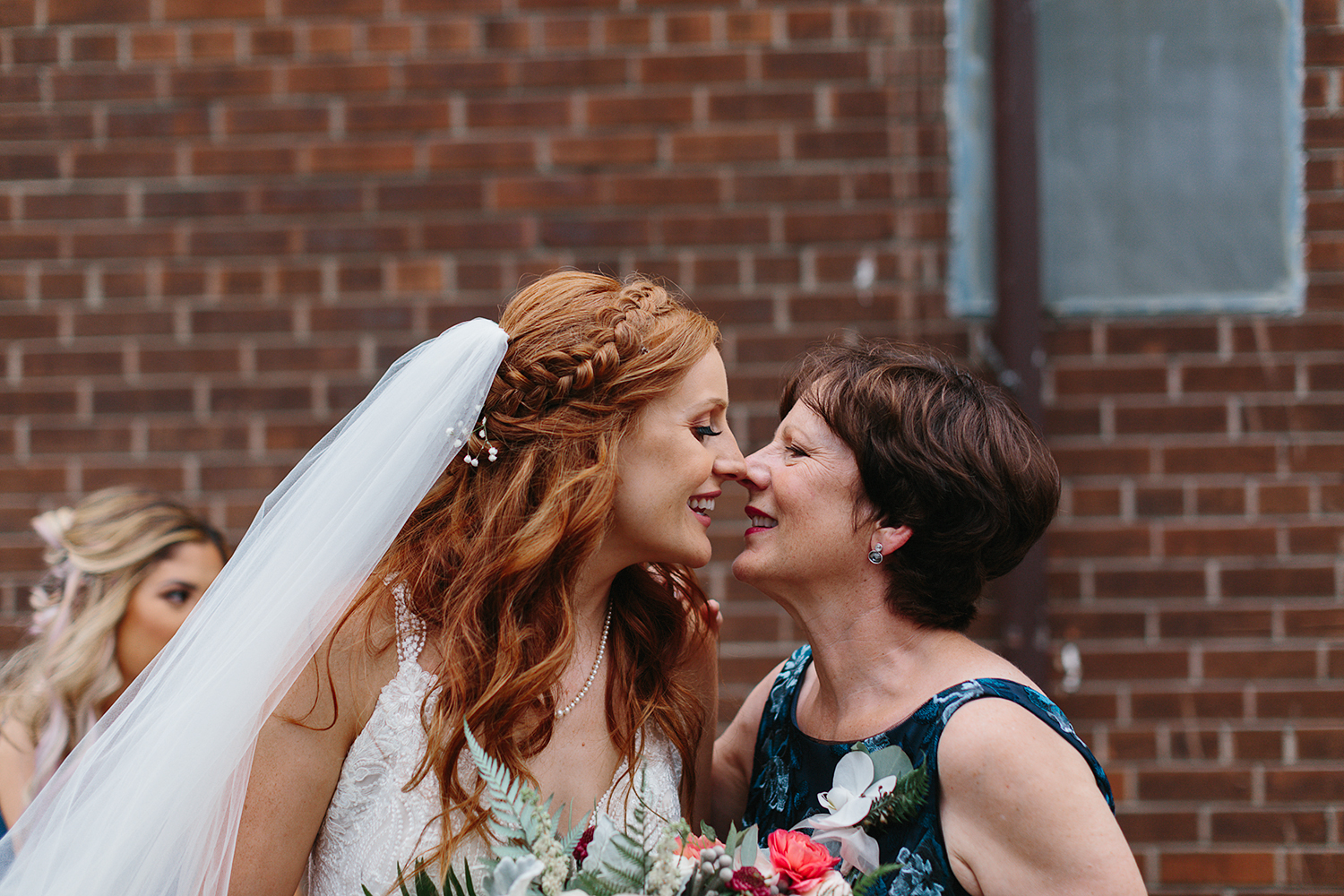 torontos-best-documentary-wedding-photographers-ryanne-hollies-photography-fine-art-photojournalism-artistic-moody-creative-inspiration-downtown-toronto-airship37-venue-modern-hipster-cocktail-hour-bride-and-mom-having-a-moment-cute.jpg