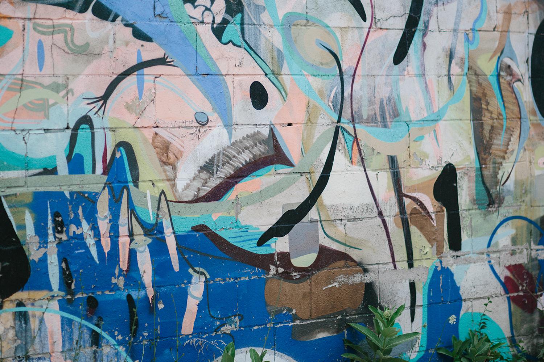 torontos-best-documentary-wedding-photographers-ryanne-hollies-photography-fine-art-photojournalism-artistic-moody-creative-inspiration-downtown-toronto-airship37-venue-modern-hipster-cocktail-hour-details-graffiti-wall.jpg