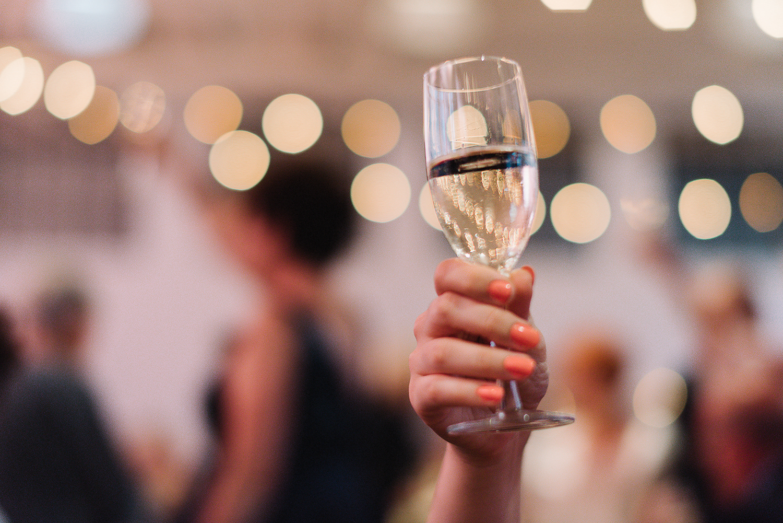 torontos-best-wedding-photographers-ryanne-hollies-photography-photojournalism-artistic-moody-toronto-airship37-graffiti-editorial-reception-bride-and-groom-speech-cheers-champagne-toast.jpg