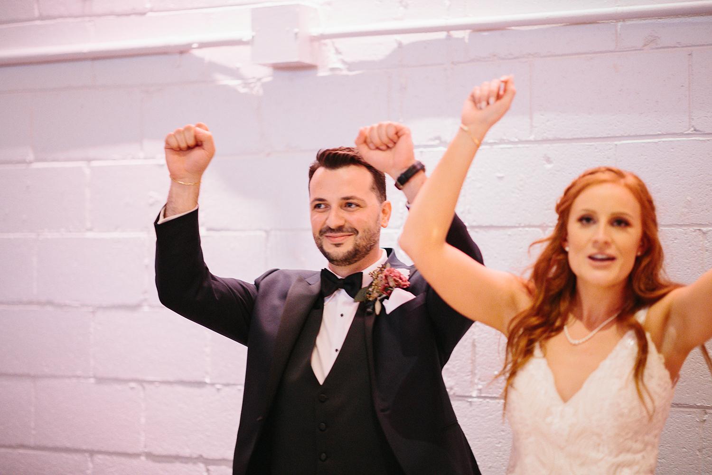 torontos-best-wedding-photographers-ryanne-hollies-photography-photojournalism-artistic-moody-toronto-airship37-graffiti-editorial-reception-bride-and-groom-entrance-funny.jpg