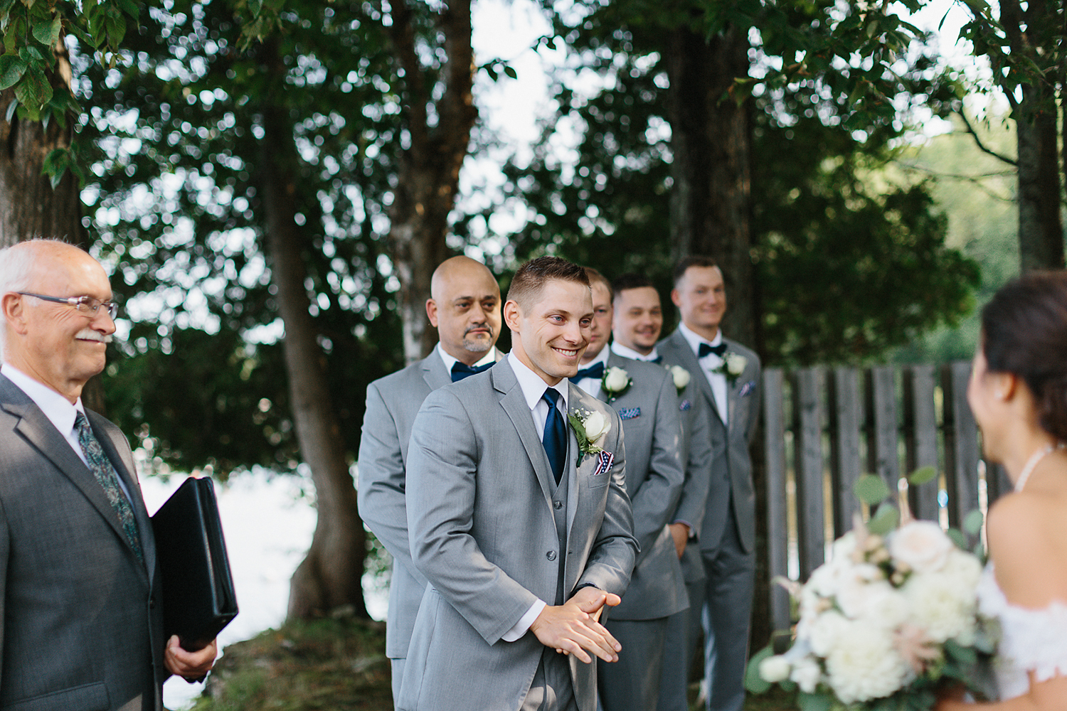 muskoka-wedding-photographer-toronto-wedding-photography-hidden-valley-resort-documentary-photojournalistic-fine-art-wedding-photography-lakeside-ceremony-cottage-country-bride-walking-down-the-aisle-candid-groom-excited-emotional.jpg