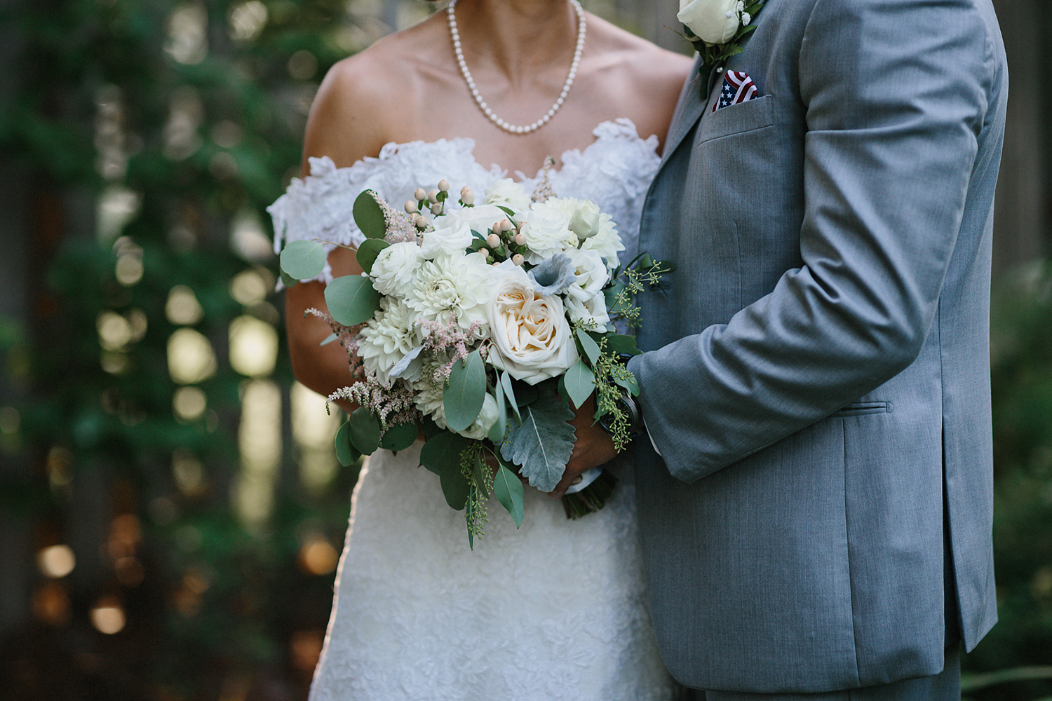 muskoka-wedding-photographer-hidden-valley-resort-film-photography-junebug-weddings-inspiration-bride-and-groom-couples-portraits-romantic-artistic-details-of-earthly-green-bouquet.jpg