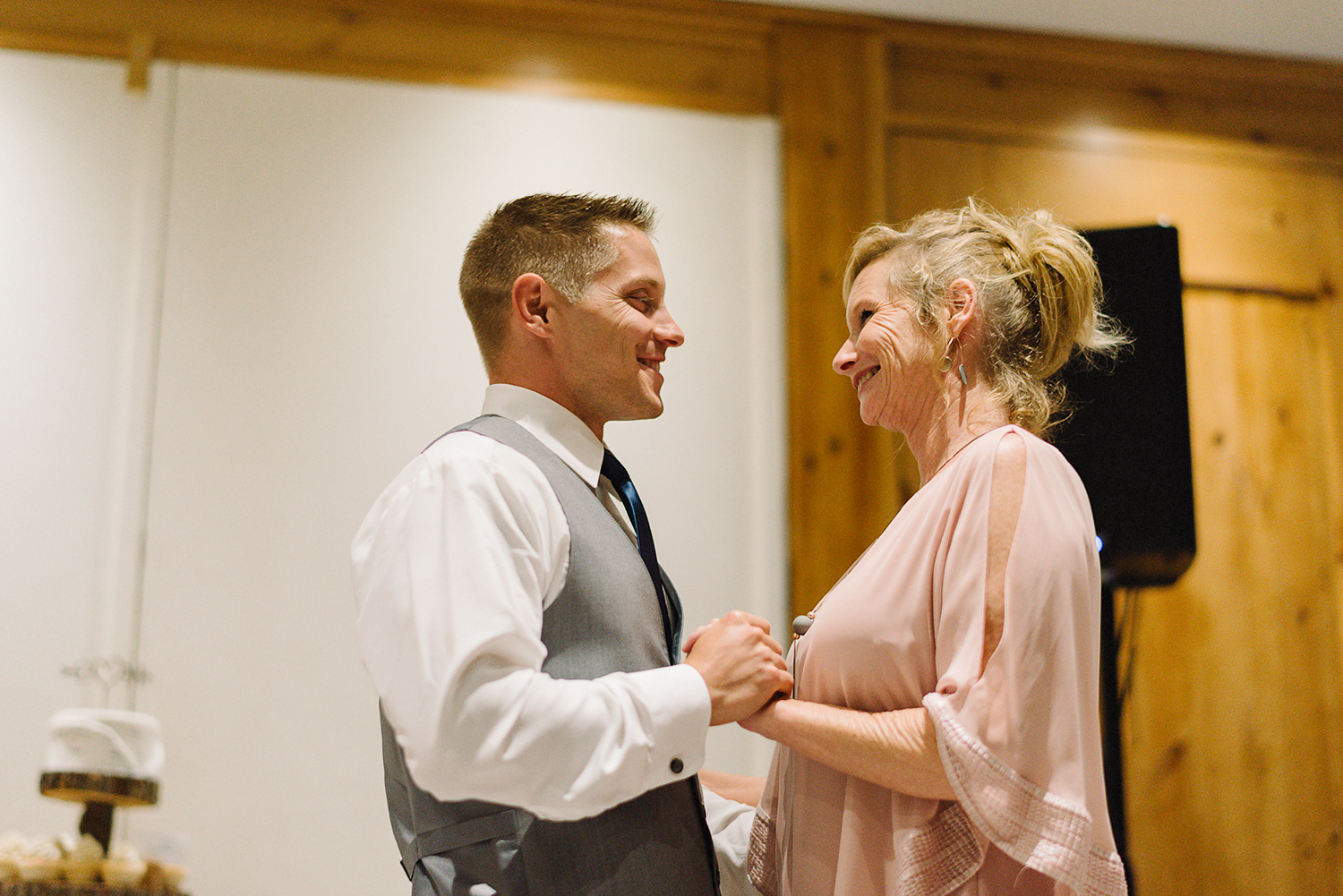 hidden-valley-resort-torontos-best-wedding-photographers-ryanne-hollies-photography-calgary-muskoka-haliburton-port-carling-cottage-wedding-at-resort-party-candid-documentary-photography-mother-son-dance-with-groom-cute-moments.jpg