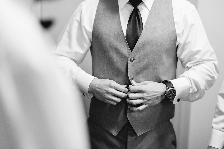 muskoka-wedding-photographer-toronto-wedding-photography-hidden-valley-resort-documentary-photojournalistic-getting-ready-groom-getting-dressed-grey-vest.jpg