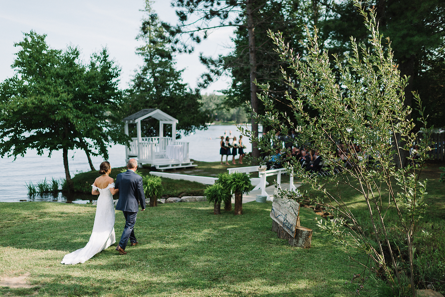 muskoka-wedding-photographer-toronto-wedding-photography-hidden-valley-resort-documentary-photojournalistic-ceremony-space-lakeside-cute-rustic-white-chapel-bride-walking-in-with-dad-epic.jpg