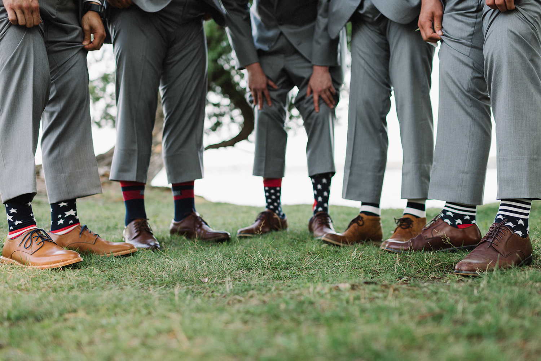 muskoka-wedding-photographer-hidden-valley-resort-film-photography-junebug-weddings-inspiration-short-bridesmaid-dresses-ideas-bridal-party-photos-unique-groomsmen-with-american-socks.jpg