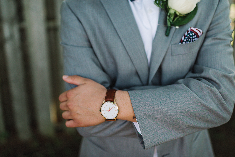 muskoka-wedding-photographer-hidden-valley-resort-film-photography-junebug-weddings-inspiration-short-bridesmaid-dresses-ideas-bridal-party-photos-unique-groom-cool-badass-brown-watch.jpg